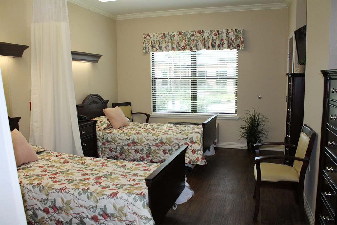 Semi-private room with separate furnishings and tv