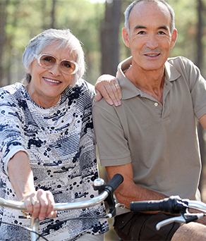 Senior couple enjoying outdoor activities/living options at the best nursing home in college station tx